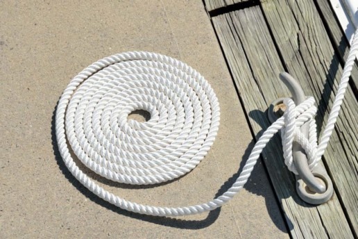 Colied rope at yacht mooring